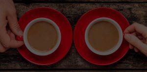 Pareja tomando cafe - Contacto Cafe Fanessi